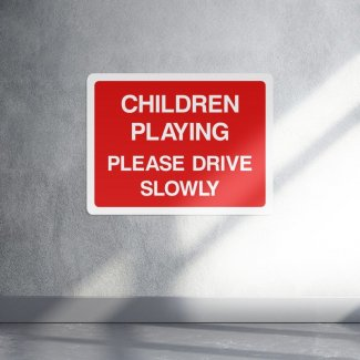 Children Playing Please Drive Slowly Sign