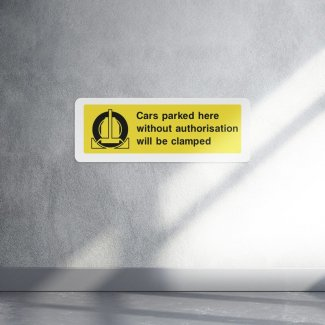 Cars Parked Here Without Authorisation Will Be Clamped Sign