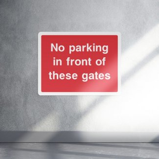No Parking in front of these gates parking sign