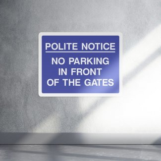 Polite notice no parking in front of these gates sign landscape