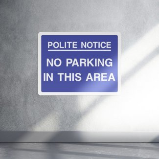 Polite notice no parking in this area parking sign