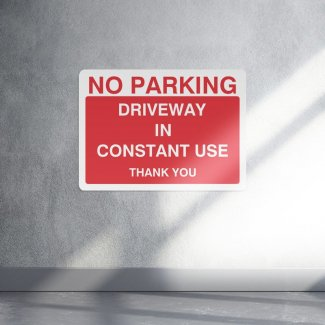 No parking driveway in constant use parking sign