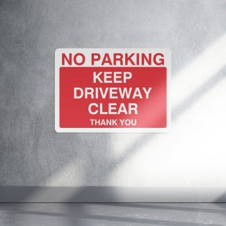No parking keep driveway clear parking sign