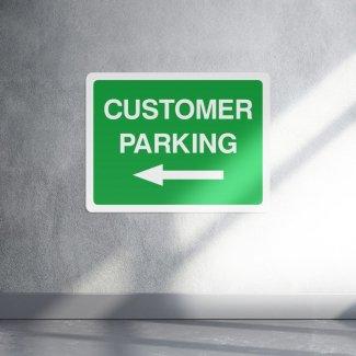Green customer parking left arrow sign - landscape