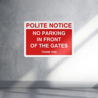 Polite notice no parking in front of these gates sign