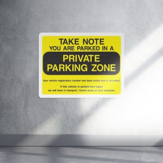 You are parked in a private parking zone security sign